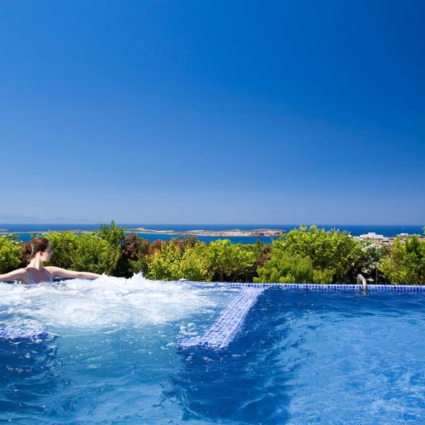 Lady relaxing in the private plunge pool with Jacuzzi at the Yria luxury villa near Parikia, Paros